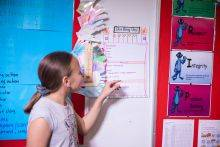 A student examines a visual schedule