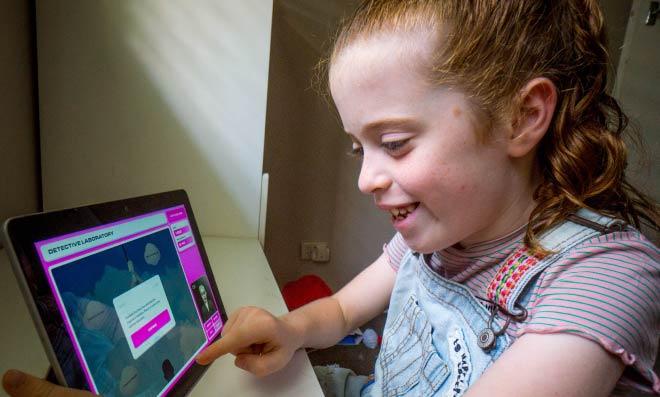 Child using SAS Digital HQ on iPad