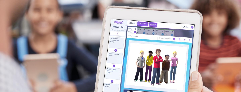 A tablet displays the SAS Small Group Program.